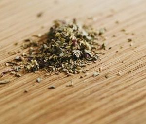 Heap Of Oregano On Wooden Table